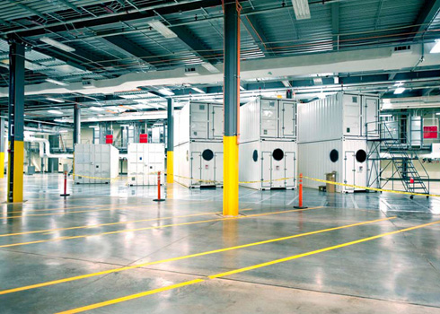Microsoft Windows Azure datacenters. Containers with their own cooling unit into large industrial halls.